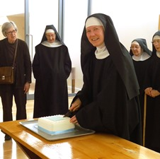 Sister Anne cutting the cake